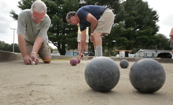 Gregory Rec/Staff Photographer -- Dick Labrecque, left, and Norman Doucet measure the distance of a ball while playing bocce ball at Sea-Vu Campground on Route 1 in Wells on Friday, August 24, 2007. (Photo by Gregory Rec/Portland Press Herald via Getty Images)
